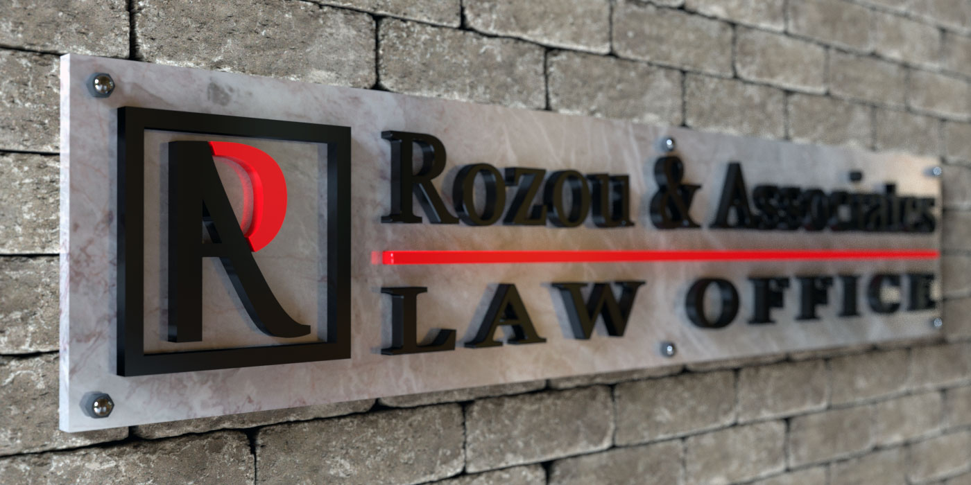 Rozou and Associates Law Office sign on the wall